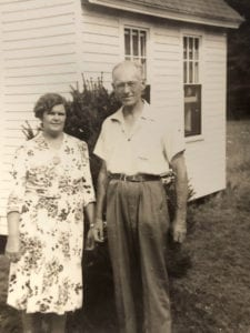 Miriam and Herbert Plimpton in front of New England Village