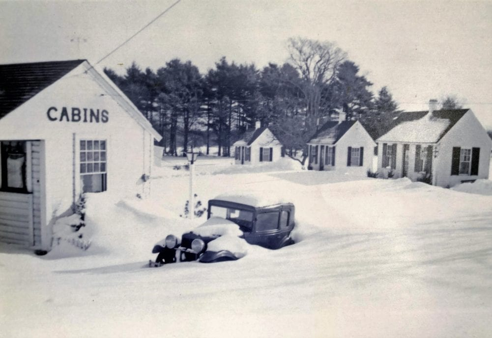 New England Village cabins covered in snow